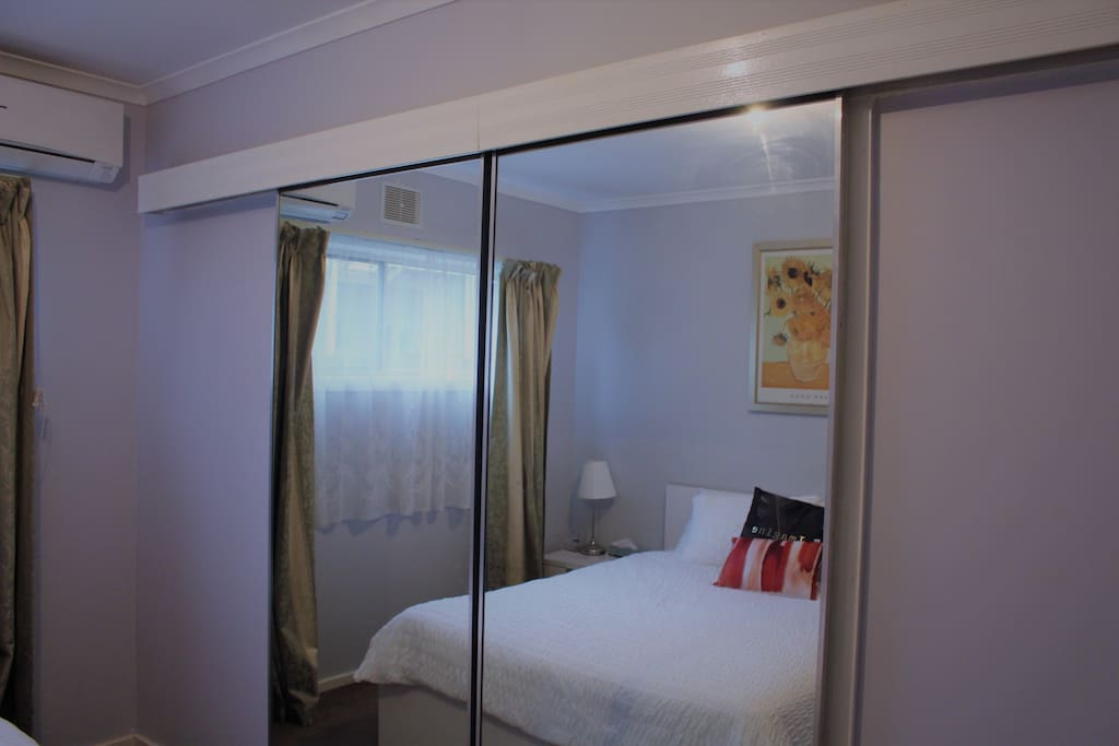 Room with sliding Mirrors Doors
