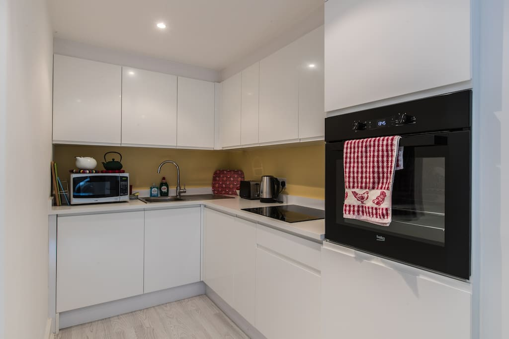 Light and bright kitchen with all modern appliance including fridge, Nespresso coffee maker, kettle, toaster, oven, hob, microwave etc.
