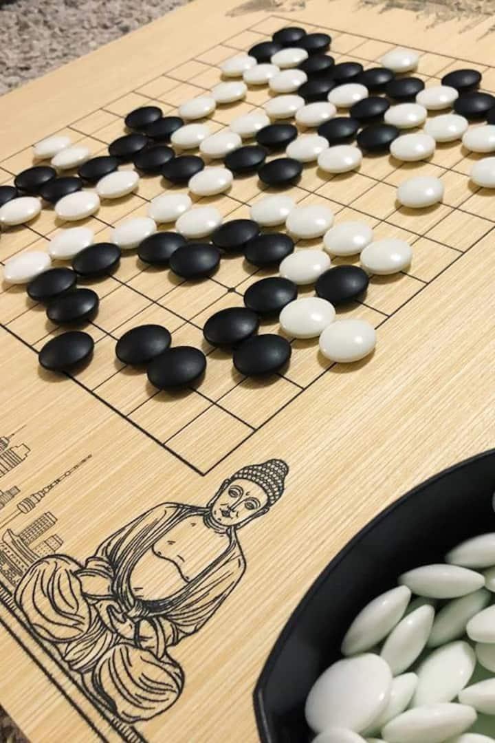 White stones, black stones, wooden board
