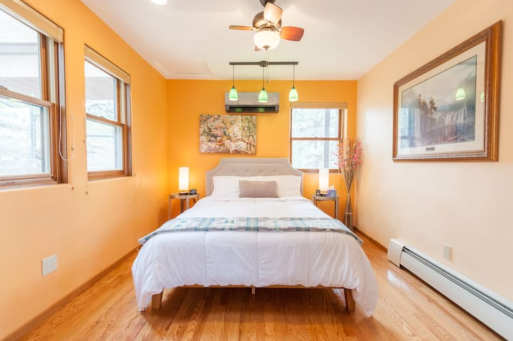 Adjacent to en-suite is the newly remodeled main floor bedroom with in-room controlled A/C -- sleeps two (2) with firm bed mattress.