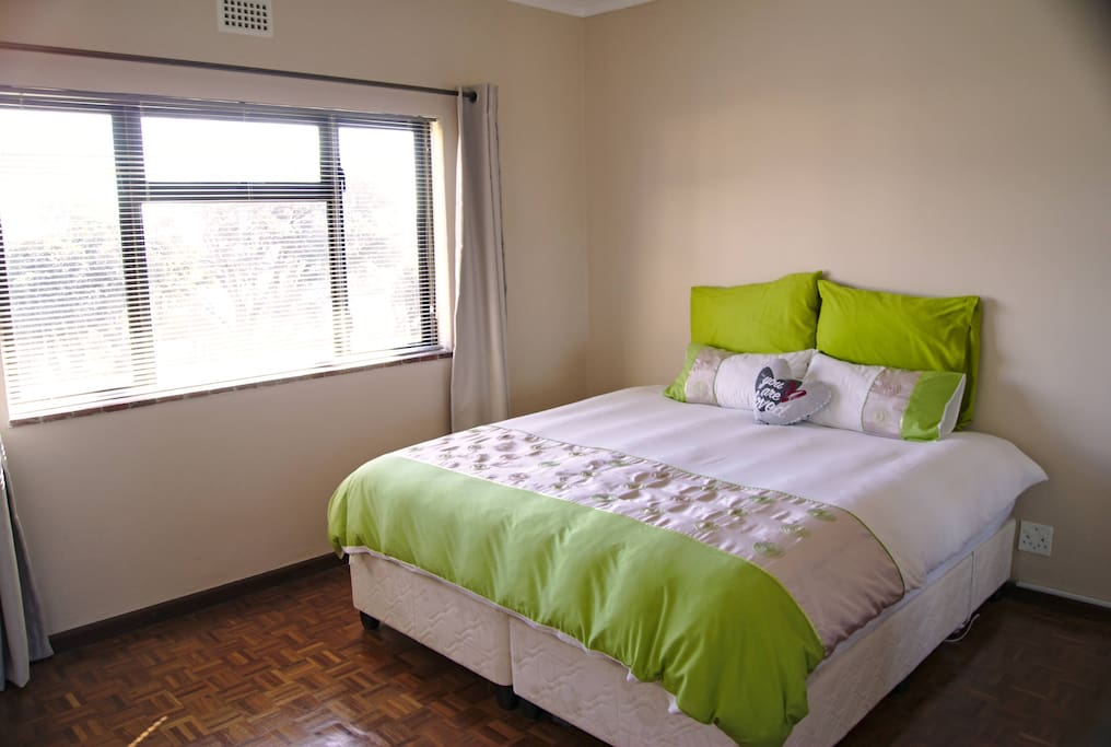 Main bedroom with king size extra length bed. Mattress type is pocketed coil.