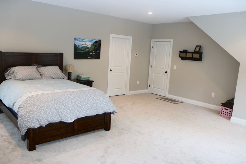 Huge bedroom with queen sized bed set.  The door on the left is the entrance to your attached extra living space.