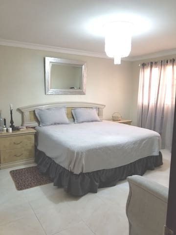 Beautiful master bedroom,  with private bathroom, walk in closet. King size bed, a desk, and air conditioner.