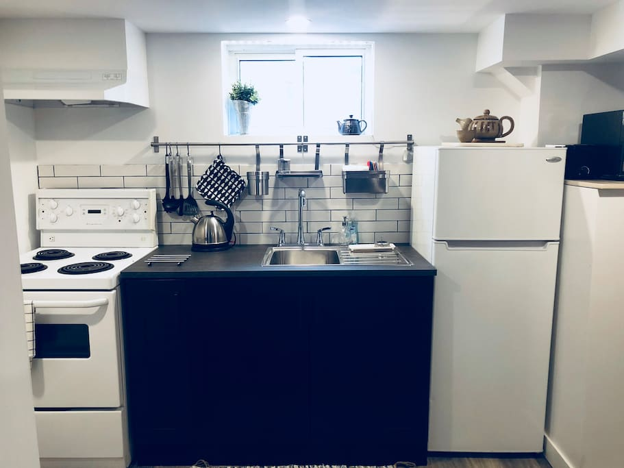 a full kitchen, with stove, fridge, microwave, toaster, and mixer!  Just ready for you to make a home-cooked meal!