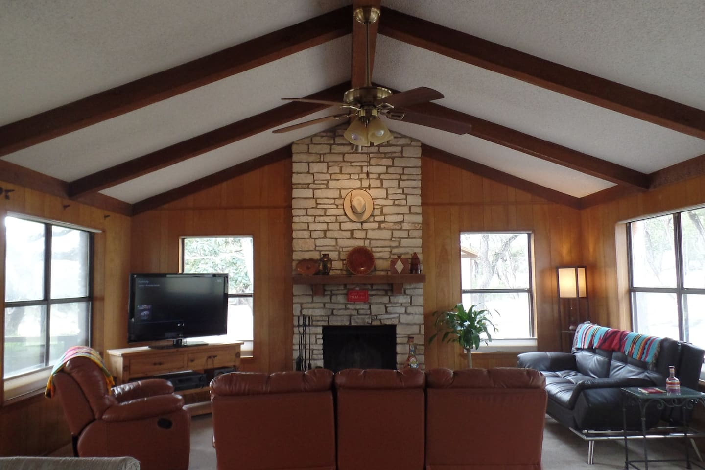 Large living/common area, vaulted ceilings, fire place, TV, Stereo, two couches, lounge chair, table and chairs for up to six and more.