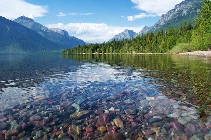 Crystal-Clear Waters and Colorful Rocks of Lake McDonald - Glacier National Park.