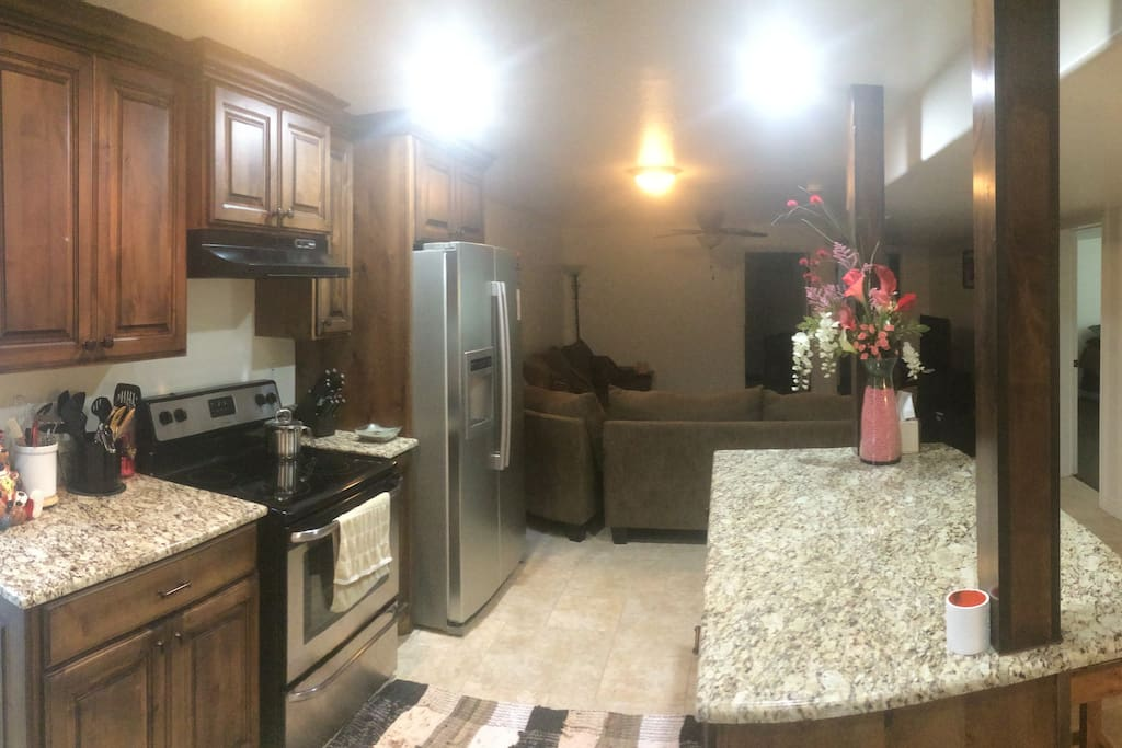 Kitchen and great room view.  Stone counters throughout.