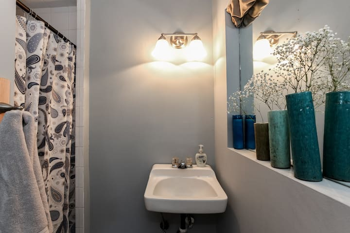 This is the second bathroom, accessible through one of the back bedrooms. It's a little smaller and cozy and is separated from the bedroom with only a curtain (no swingable room for a door).