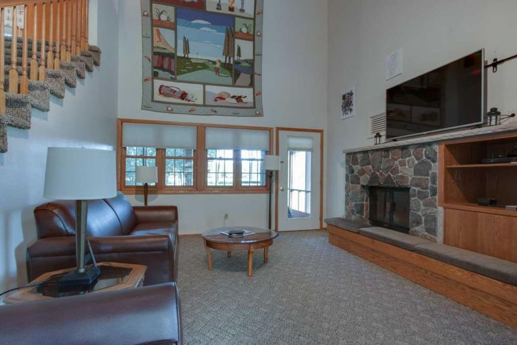 Large, open great room with wood burning fireplace
