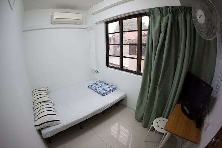 Queen bedroom with shared bathroom