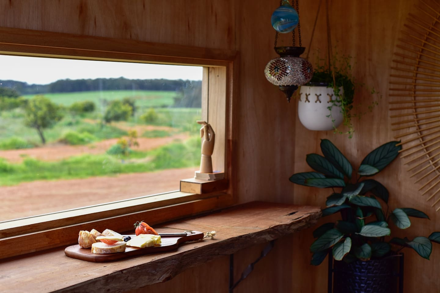 The breakfast bar has a northerly view overlooking pasture and baby avocado trees.