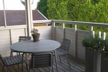 Outdoor roofed balcony , afternoon and evening sun