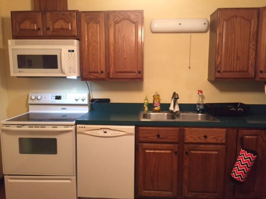 Kitchen includes Stove, Fridge, Microwave, Double sink, Dishwasher