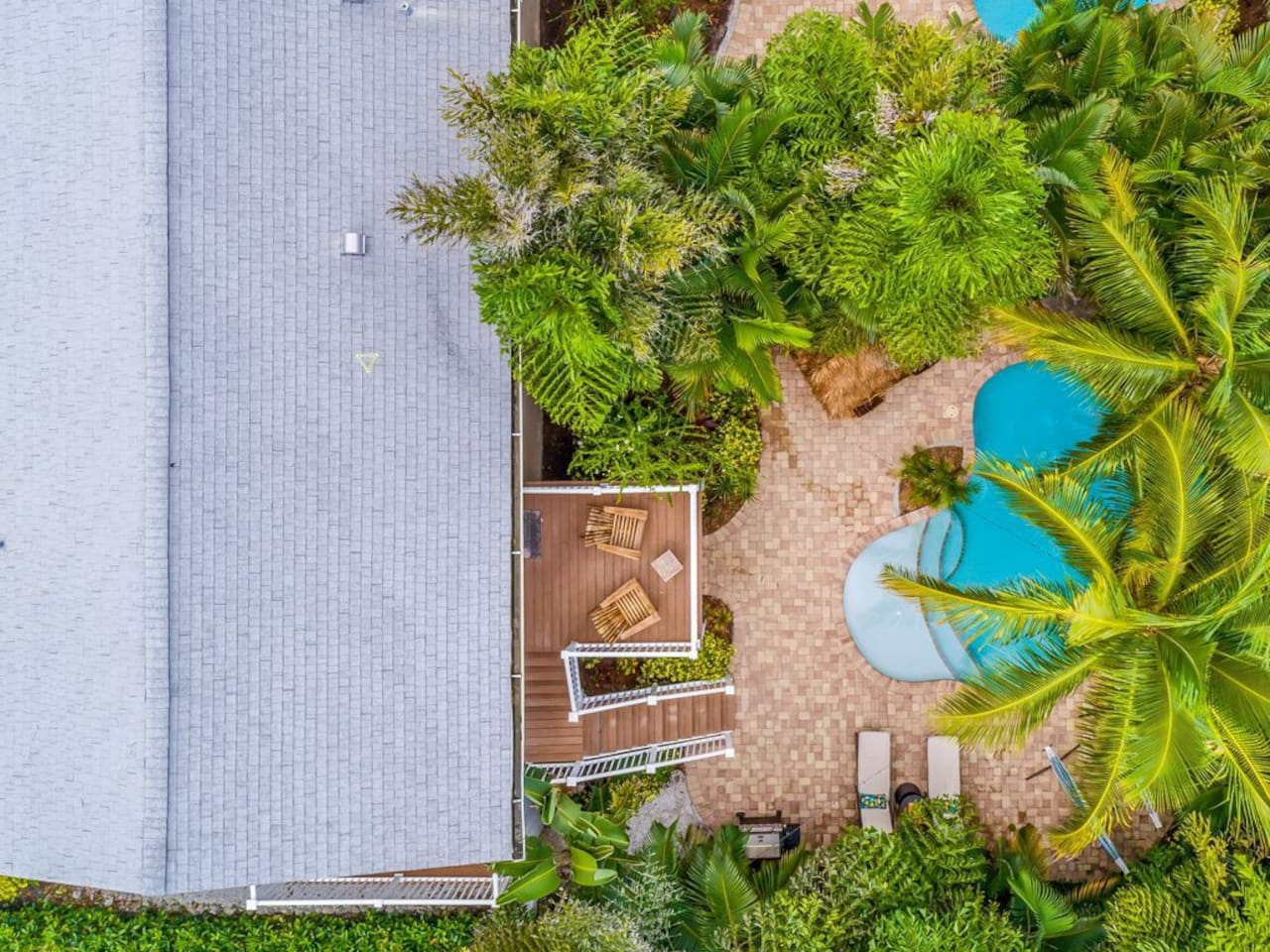 Plush tropical landscaping provides a great barrier and makes the backyard your own PRIVATE oasis