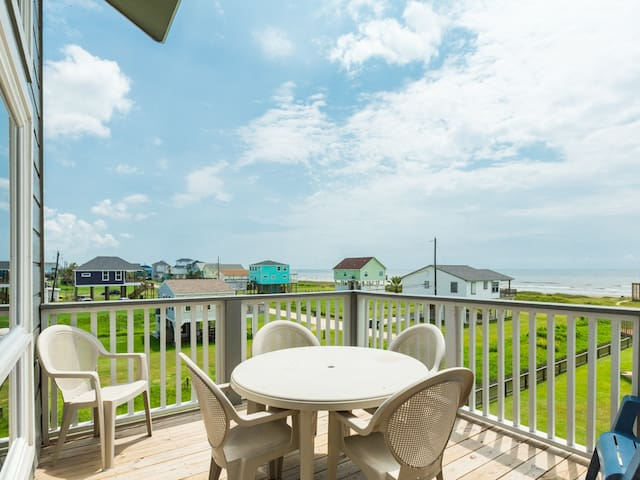 Outdoor seating on the patio offers stunning ocean views.