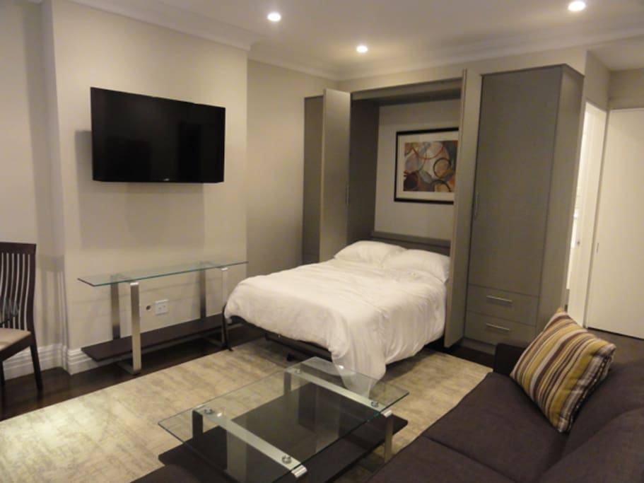 Super comfortable Full/Double Size Bed with custom cabinetry