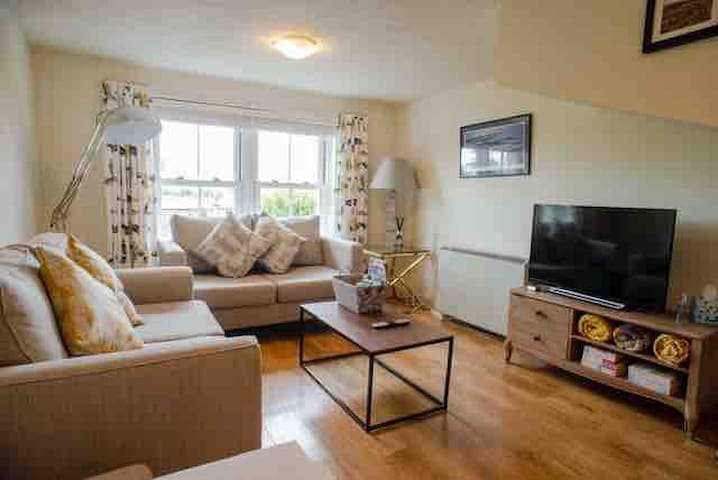 Duplex apartment centrally located with parking
