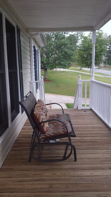 Covered front porch perfect for sipping some sweet tea!
