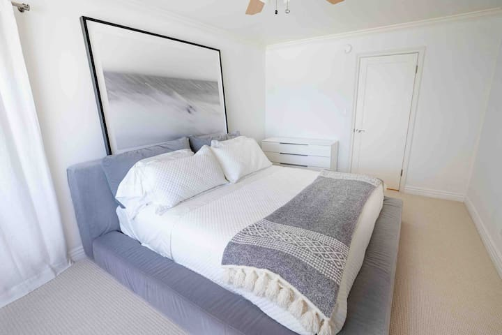 Master bedroom, king bed with views of ocean. Direct access to the bathroom and balcony deck.