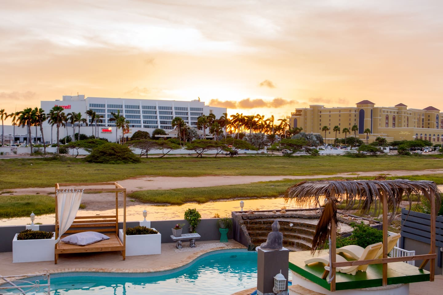 Sunset On Property With View Of Marriott Ritz Carlton