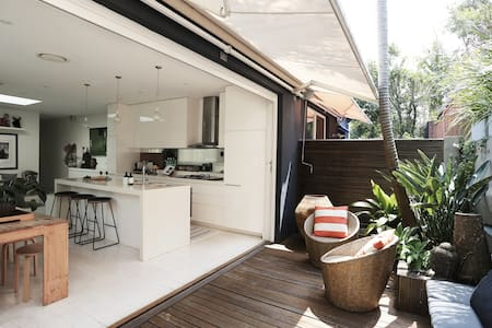 Explore the Coast from a Stylish Beachside Oasis