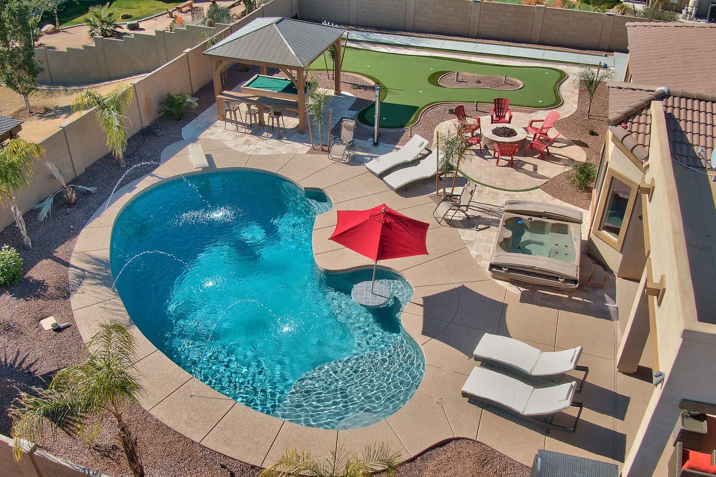 Huge Heated Pool , Sit around table in pool. Hot Tub. Large Deck Lounging Area.