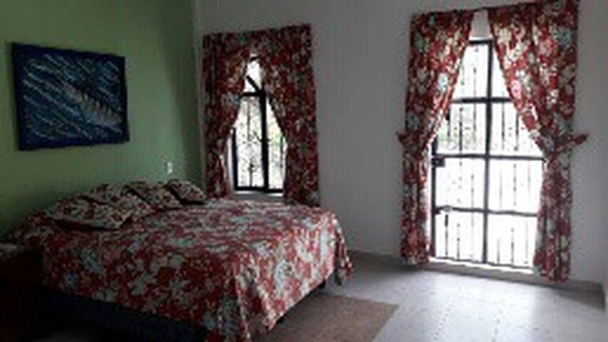 Light & airy bedroom w/ private bathroom & balcony
