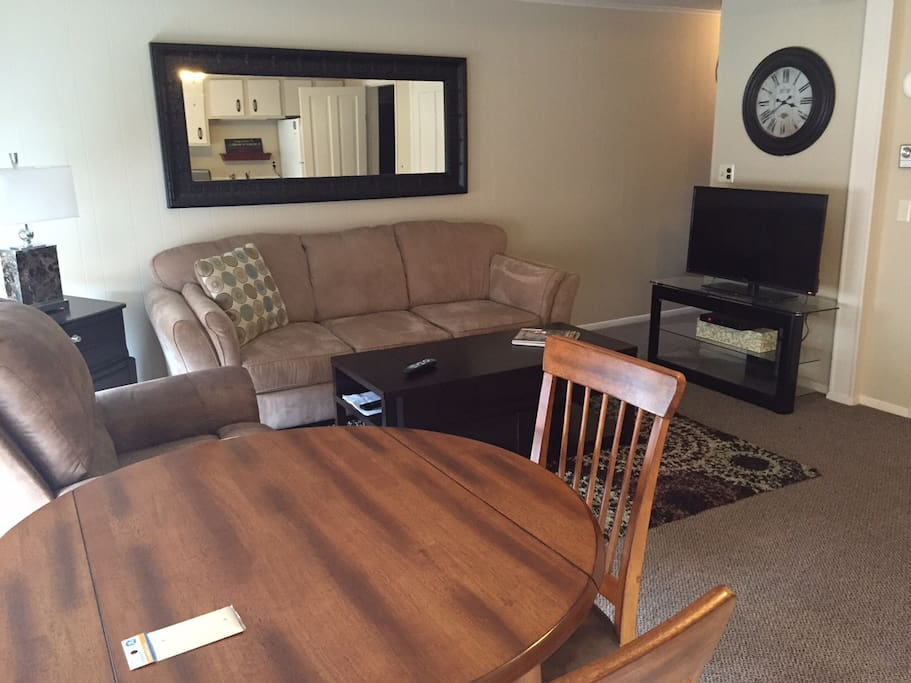 """Living room with sleeper sofa, recliner and 40"""" flat screen tv with cable"""