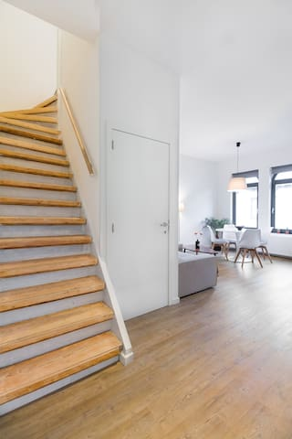 An authentic wooden stairs takes you to the 2nd floor of the duplex