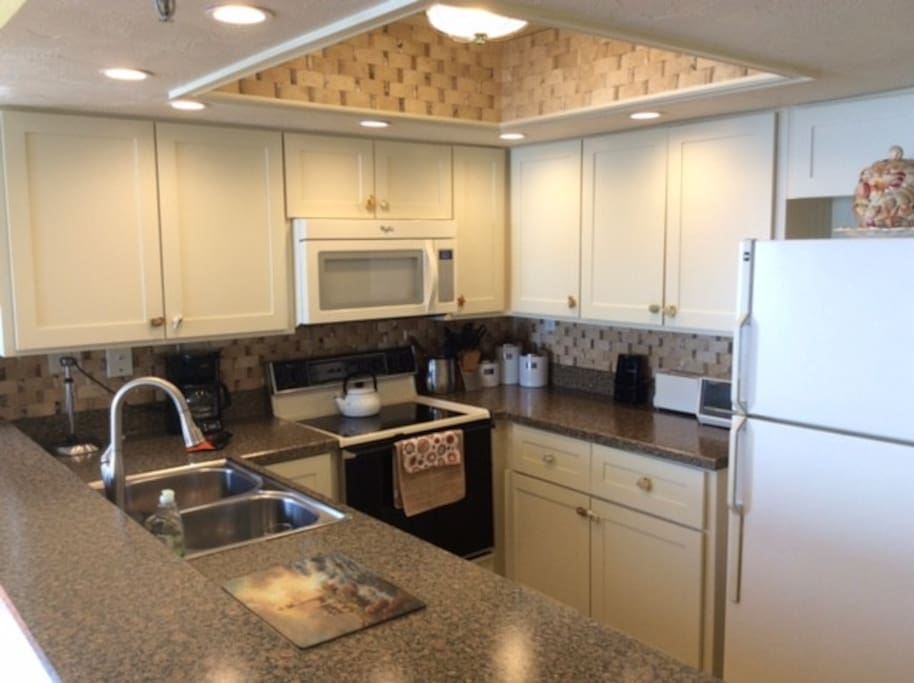 Newly renovated kitchen with stunning natural and recessed lighting. The kitchen is fully stocked-- you can cook a Thanksgiving dinner here!