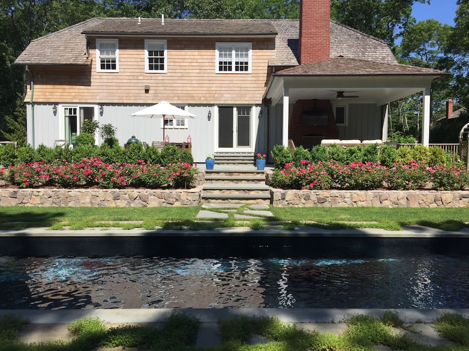 Beautifully landscaped back yard with pool and patio