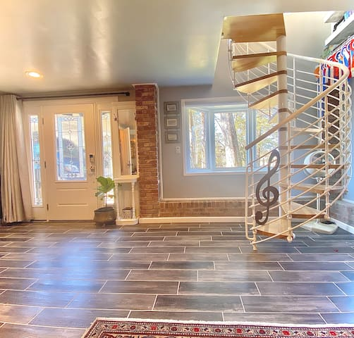 Downstairs Bedroom of The Carriage House w/Spiral Staircase & Bay Window