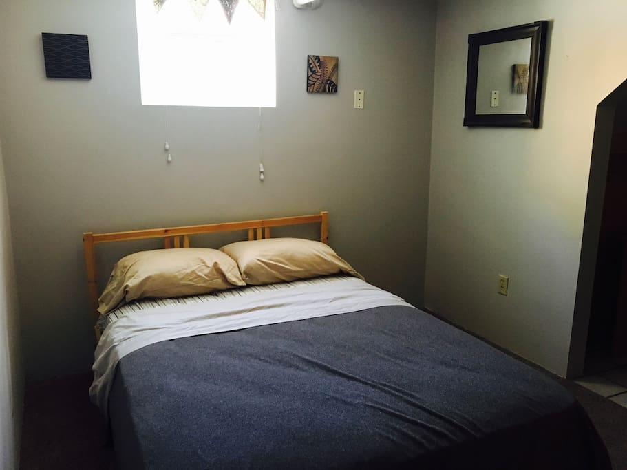 Bedroom #1: Full Size bed, closet, and desk to work at.