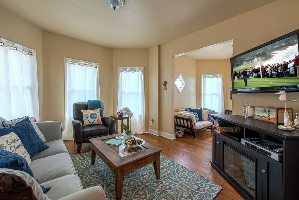 Living room has a 48-inch HDTV and a sleeper sofa that can accommodate two.