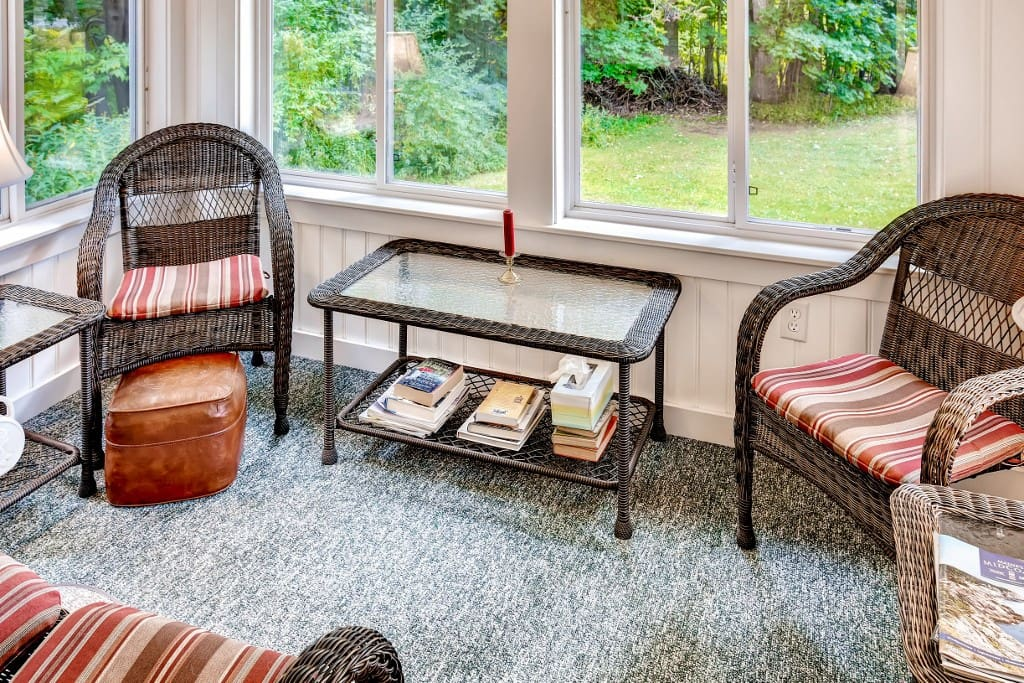 Enjoy the picturesque surroundings from the comfort of this enclosed sun porch!
