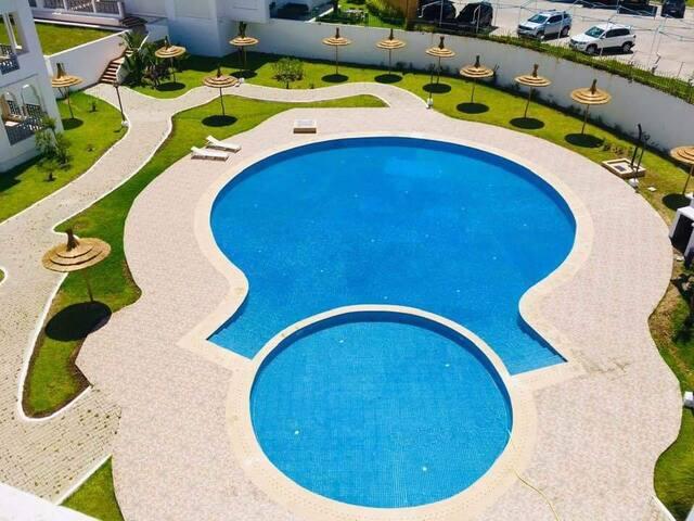 Appartement avec piscine au bord de la mer