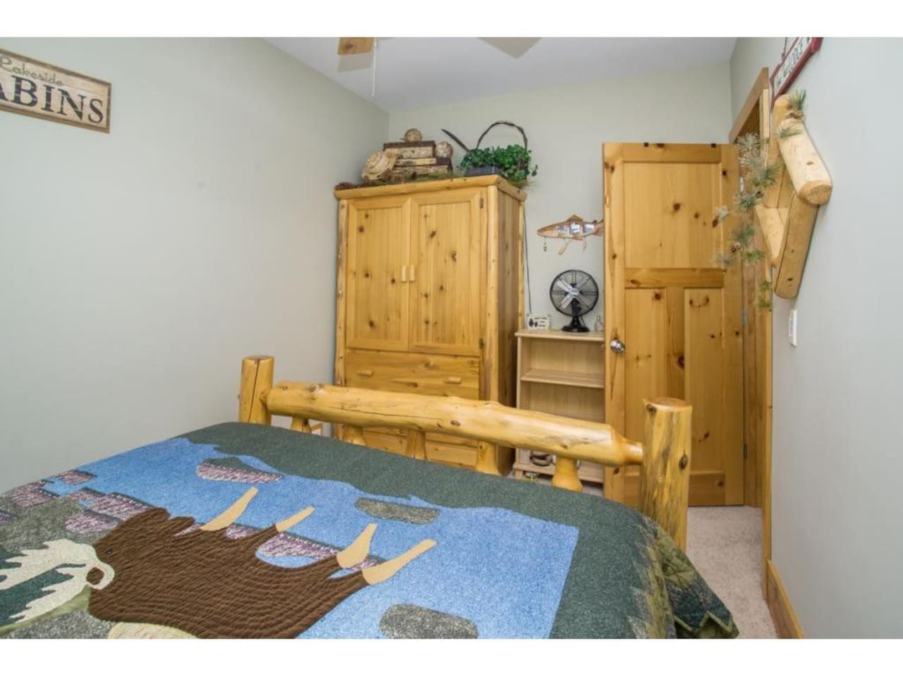 Moose room is beautifully decorated with more authentic knotty log furniture.