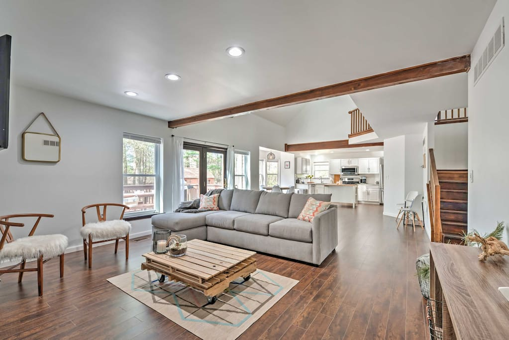 Recently remodeled, this incredible home features a spacious open layout and  new modern-rustic furnishings.