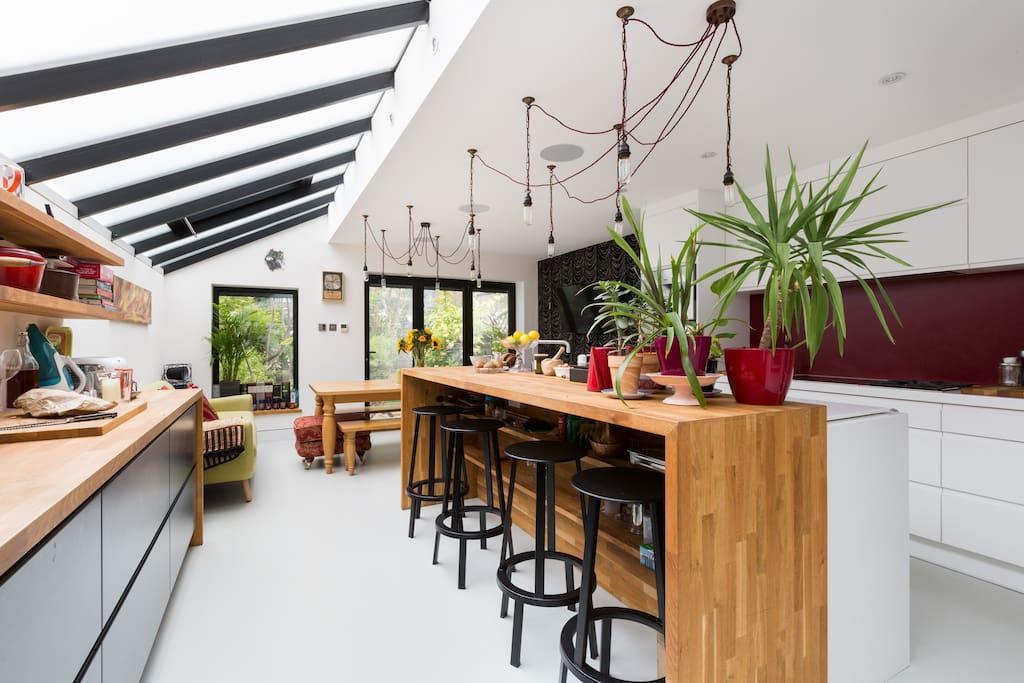 The oak breakfast bar in the stylish, modern open plan kitchen/dining room