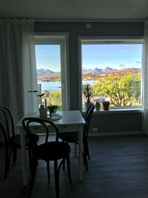 Enjoy a stunning view from the dinner table. From here you can sit and enjoy northern lights, midnight sun and see the boats sailing into Tromsø.