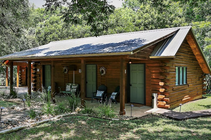 """The """"Log Cabin Suites""""  3 Private Suites in One Log Cabin.  Private access to your room with shared front porch."""