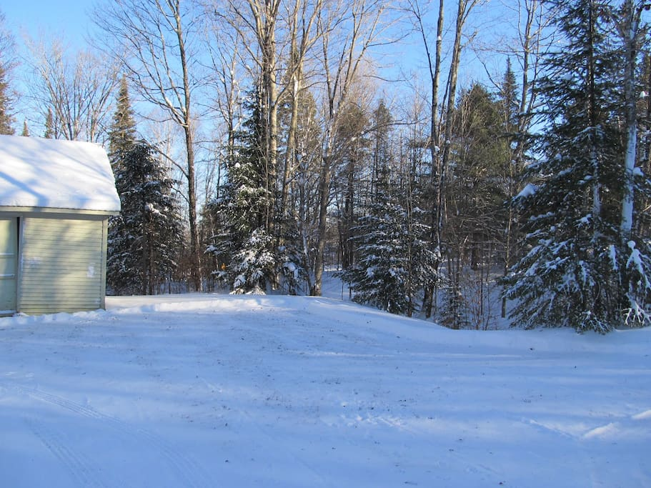 Barn & Parking area for trailers and snow machines.