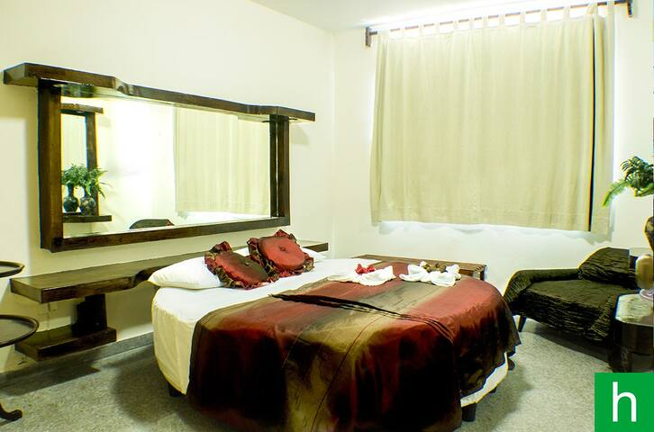Room #2 with AC, amazing round bed, Flat TV and beautiful window seaview