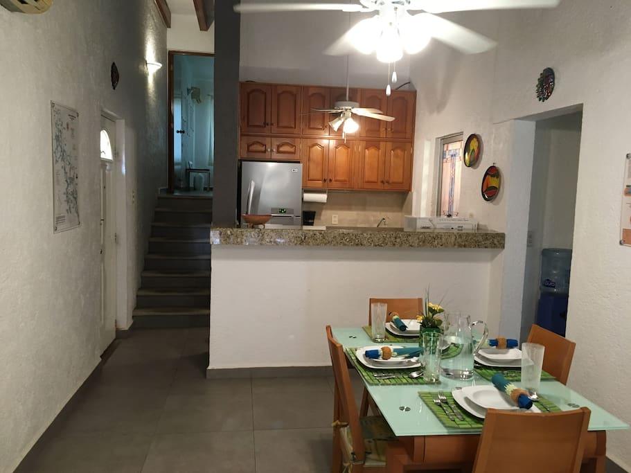 Dining room, kitchen. second bedroom upper level