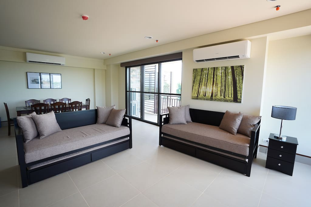 Living and dining area with sliding doors to balcony