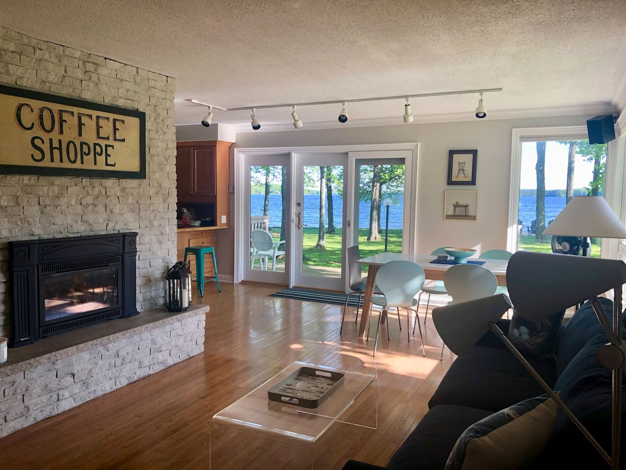 Open concept living room, dining room with walk out to deck and spectacular views
