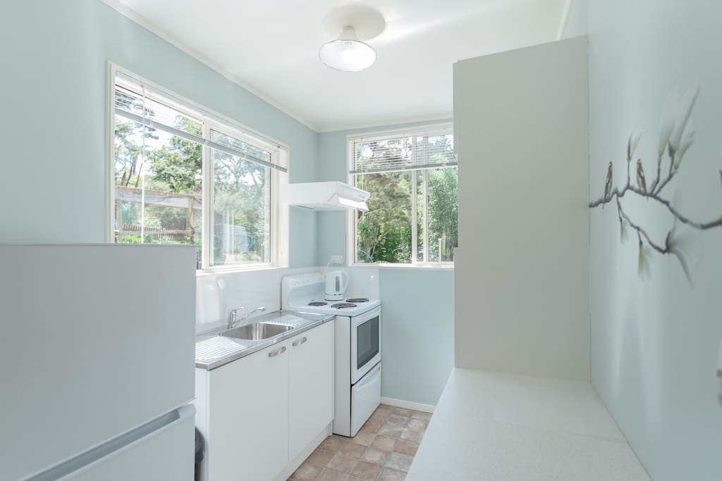 Fully equipped kitchen with microwave full size oven and fridge freezer.