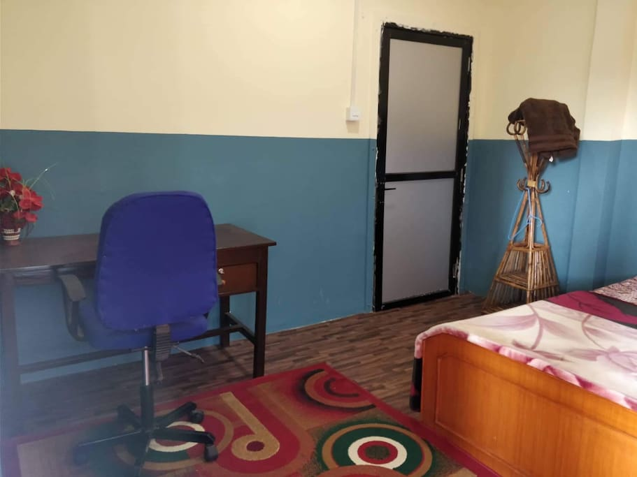 Double-bed Bedroom with a study table, cupboard, separate bathroom with proper bath (tub)