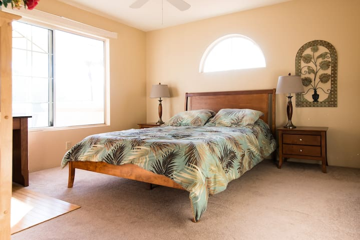 Guest master-suite- very bright and sunny with mountain views