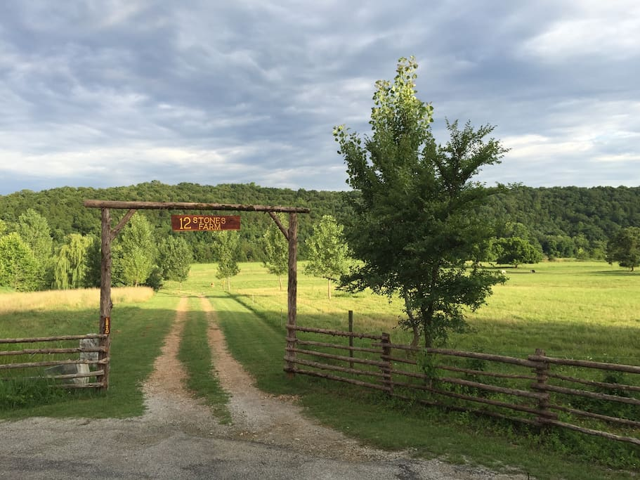 Entrance to the farm leads down to your cabin next to Swan Creek.